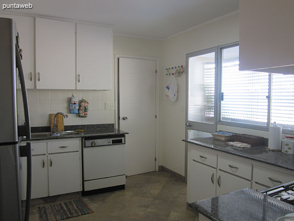General view of the kitchen. It has direct access to the living room and connects directly with the bedroom and bedroom corridor of the apartment.