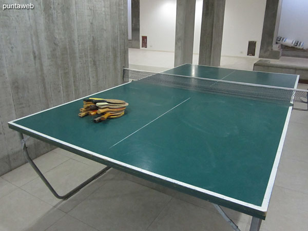 Game room for teenagers. located in the basement of the building. It has foosball and ping pong tables.