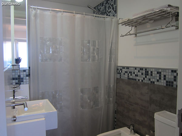 Second bathroom Interior, equipped with shower and bathroom curtain.