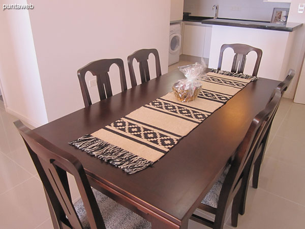 Rectangular wooden table with six chairs.