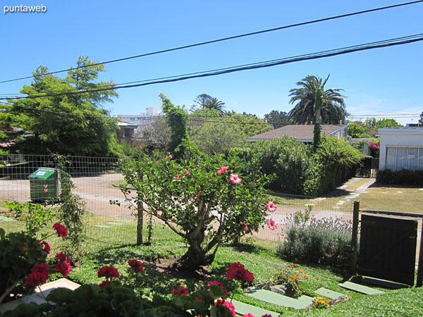 View towards the surroundings of the fenced garden in front of the apartment from the bedroom window.
