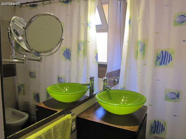 Bathroom, complete; with exterior window. It has a shower, bathtub and shower curtain.