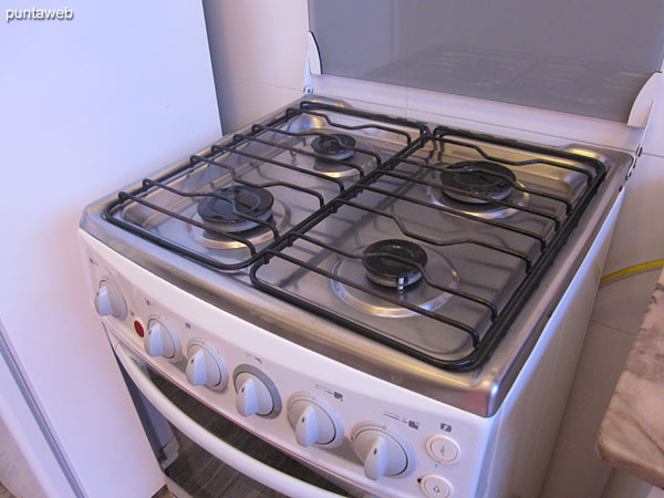 Gas stove with four burners.