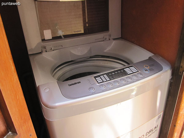 Washing machine. Located in a closed compartment next to the barbecue.