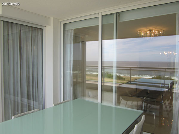 Balcony terrace of the apartment, accessible from living room and master suite.<br><br>It has a barbecue.