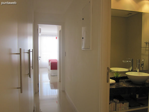 Access corridor to the two remaining suites. To the right of the image the toilette.