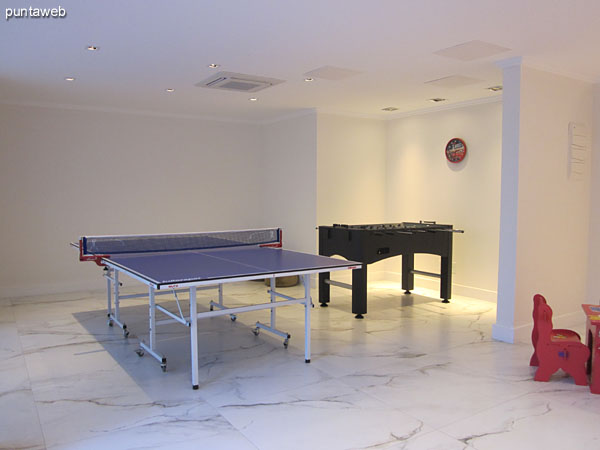 Playroom for children and adolescents. Located lobby level of the building.<br><br>Equipped with ping–pong, foosball and other games for children.