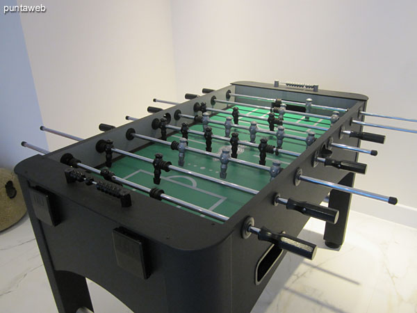 Detail of foosball in the game room for children and teenagers.