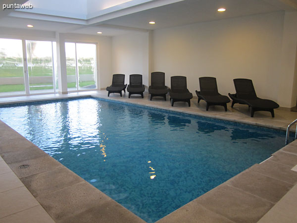 Heated pool under roof. Located at the level of the lobby of the building towards the quiet part of the building.
