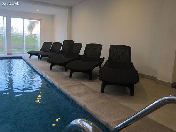 Detail of chairs in the heated pool of the building.