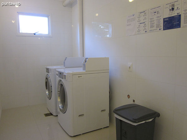 Laundry space. Equipped with machines by chips.