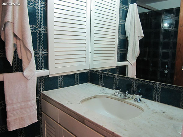 Second bathroom Inside. Equipped with shower and bath screen.