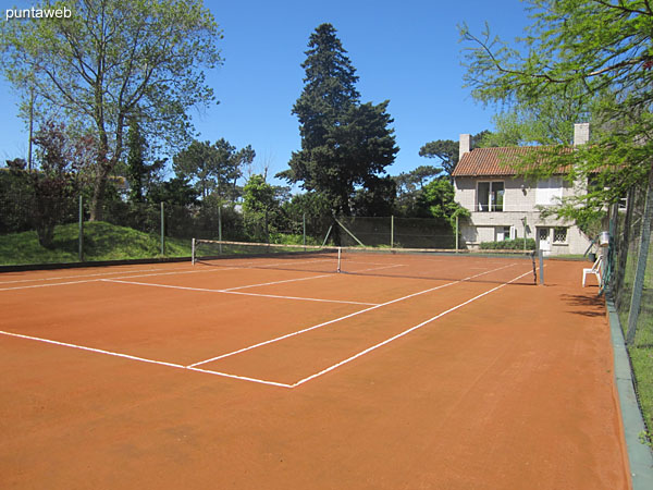 The building has two brick dust courts.