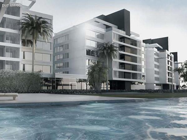 Contrafrente del edificio con perspectiva de una piscina en zona de amenities.