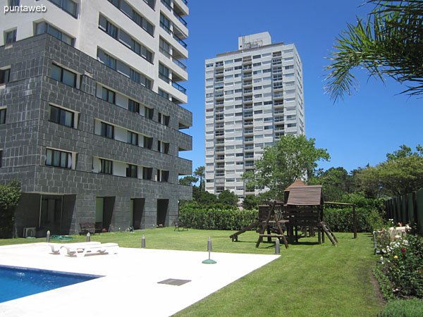 General view of the outdoor pool from the back left corner of the property into the building.