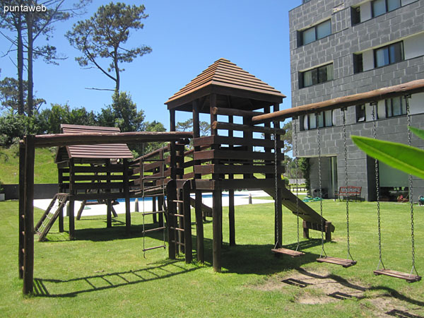 Detail playground for kids in the garden of the building.