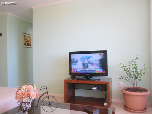 Details of the provision of TV table in the living environment.<br><br>To the right of the image, large double–paned window that provides access to the terrace balcony.