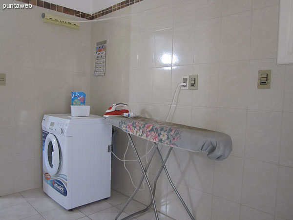 Laundry. Access from the kitchen and separate door. Very wide. Equipped with sink and washing machine.