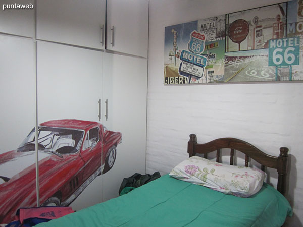 Third bedroom. Located on the upper floor towards the east side. It has a single bed.